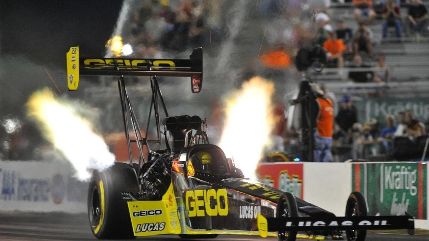 In this photo provided by the NHRA, Richie Crampton races to the provisional No. 1 qualifying spot in Top Fuel at the AAA Insurance NHRA Midwest Nationals drag races at Gateway Motorsports Park on Friday, Sept. 26, 2014, in Madison, Ill. (AP Photo/NHRA, Teresa Long)
