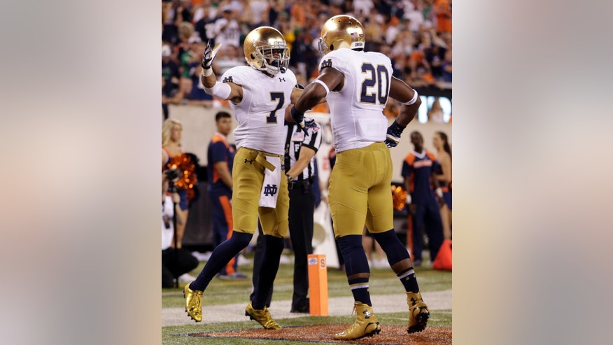 Notre Dame wide receiver William Fuller, left, and wide receiver C.J. Prosise celebrate a touchdown by Fuller during the first half of an NCAA college football game against Syracuse, Saturday, Sept. 27, 2014, in East Rutherford, N.J. (AP Photo/Julio Cortez)