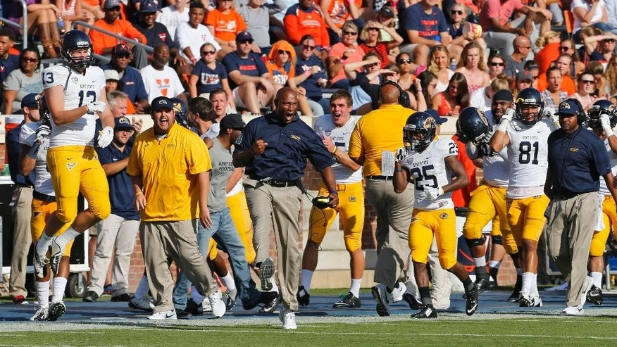 The Kent State bench erupts after an interception by Kent State defensive tackle Jontey Byrd (56) during the first half of an NCAA college football game in Charlottesville, Va., Saturday, Sept. 27, 2014.   (AP Photo/Steve Helber)