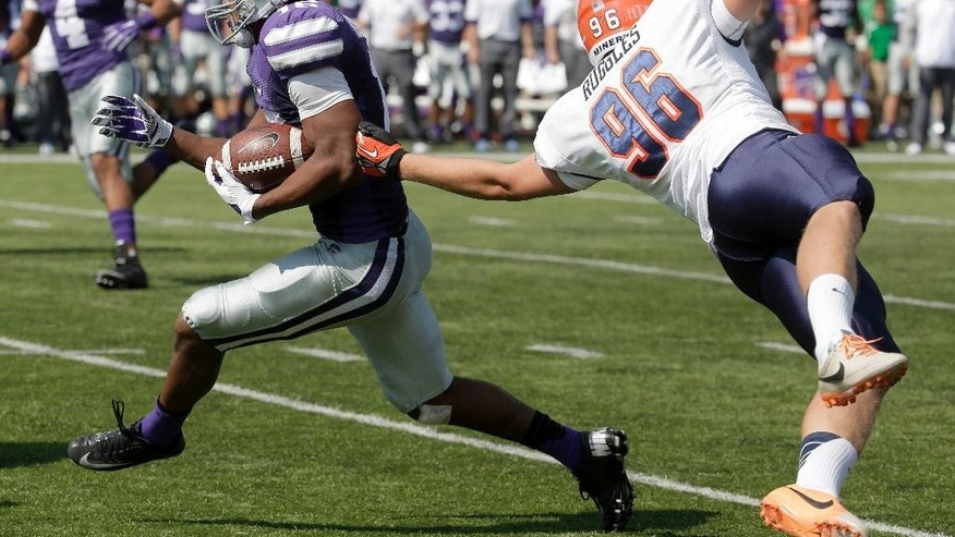 Kansas State wide receiver Tyler Lockett, left, gets past UTEP place kicker Mike Ruggles (96) to return a punt for a touchdown during the first half of an NCAA college football game against UTEP, Saturday, Sept. 27, 2014, in Manhattan, Kan. (AP Photo/Charlie Riedel)