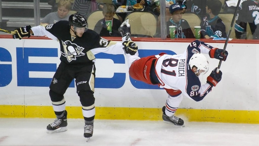 Columbus Blue Jackets' Brett Ponich (81) tries to get around Pittsburgh Penguins' Zach Sill (38) in the second period of the NHL pre-season hockey game, Saturday, Sept. 27, 2014 in Pittsburgh. (AP Photo/Keith Srakocic)