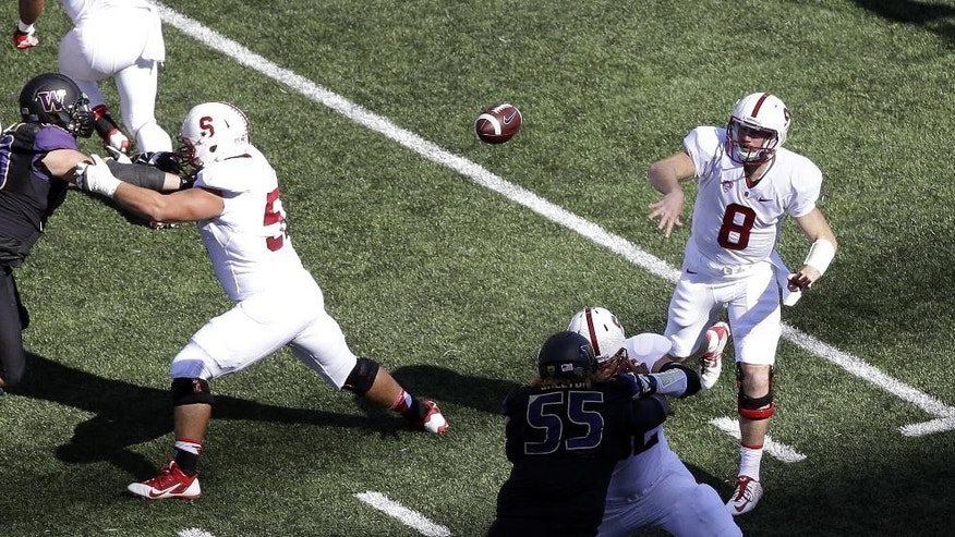 Stanford quarterback Kevin Hogan (8) throw against Washington in the first half of an NCAA football game Saturday, Sept. 27, 2014, in Seattle. (AP Photo/Elaine Thompson)