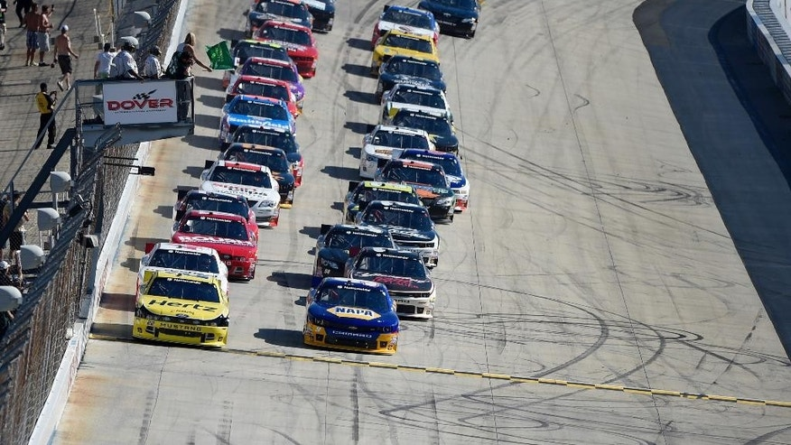 The field led by Joey Logano, left front, and Chase Elliott, right front, take the green flag for the start of the NASCAR Nationwide series auto race, Saturday, Sept. 27, 2014, at Dover International Speedway in Dover, Del. (AP Photo/Nick Wass)