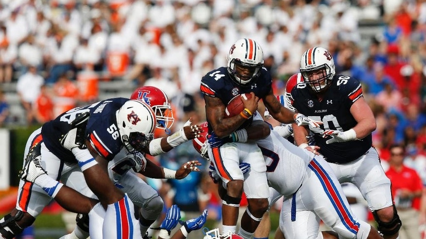 Auburn quarterback Nick Marshall (14) runs the ball during the first half of an NCAA college football game against Louisiana Tech on Saturday, Sept. 27, 2014, in Auburn, Ala. (AP Photo/Brynn Anderson)