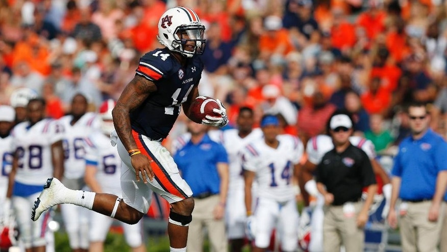 Auburn quarterback Nick Marshall runs the ball during the first half of an NCAA college football game against Louisiana Tech on Saturday, Sept. 27, 2014, in Auburn, Ala.(AP Photo/Brynn Anderson)