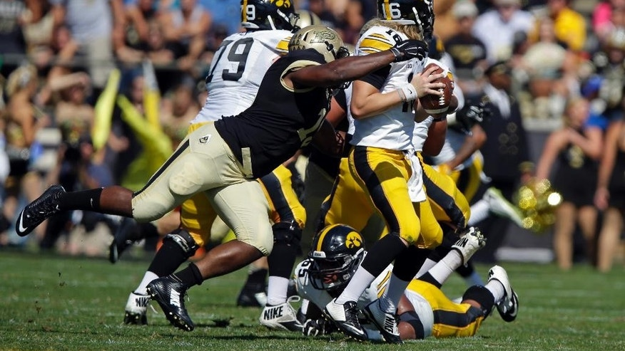 Iowa quarterback C.J. Beathard, right, is sacked by Purdue linebacker Gelen Robinson during the first half of an NCAA college football game in West Lafayette, Ind., Saturday, Sept. 27, 2014. (AP Photo/Michael Conroy)