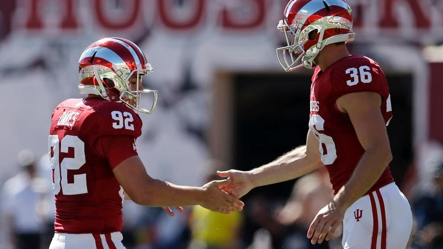 Indiana place kicker Griffin Oakes is congratulated by Erich Toth after Oakes kicked a 30-yard field goal during the first half of an NCAA college football game against Maryland, Saturday, Sept. 27, 2014, in Bloomington, Ind. (AP Photo/Darron Cummings)