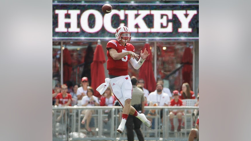 Wisconsin quarterback Tanner McEvoy throws a pass during the first half of an NCAA college football game against South Florida, Saturday, Sept. 27, 2014, in Madison, Wis. (AP Photo/Morry Gash)