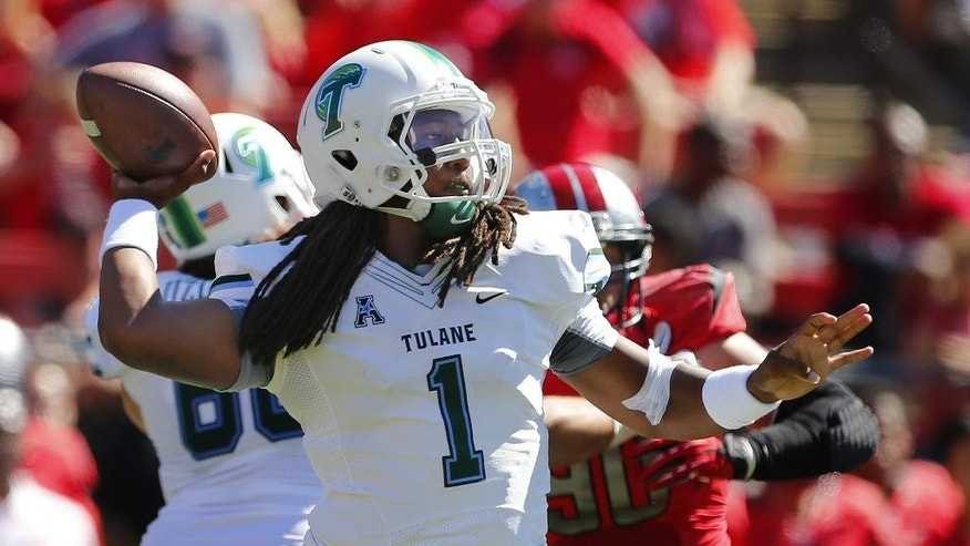 Tulane quarterback Devin Powell (1) looks to pass against Rutgers during the first half of an NCAA college football game Saturday, Sept. 27, 2014, in Piscataway, N.J. (AP Photo/Rich Schultz)