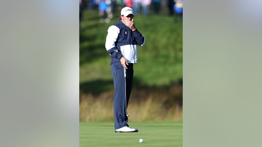 Phil Mickelson of the US misses a putt on the 7th green during the foursomes match on the first day of the Ryder Cup golf tournament, at Gleneagles, Scotland, Friday, Sept. 26, 2014. (AP Photo/Peter Morrison)