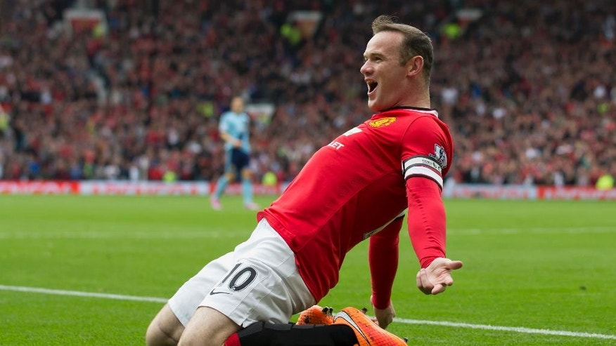 Manchester United's Wayne Rooney celebrates after scoring against West Ham United during their English Premier League soccer match at Old Trafford Stadium, Manchester, England, Saturday Sept. 27, 2014. (AP Photo/Jon Super)