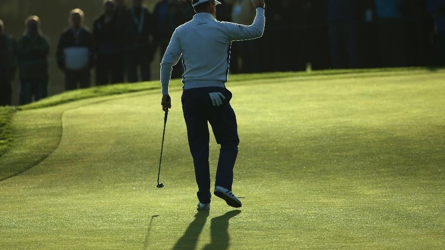 Europe's Justin Rose celebrates after putting on the 2nd green to win the hole during the fourball match on the second day of the Ryder Cup golf tournament, at Gleneagles, Scotland, Saturday, Sept. 27, 2014. (AP Photo/Peter Morrison)