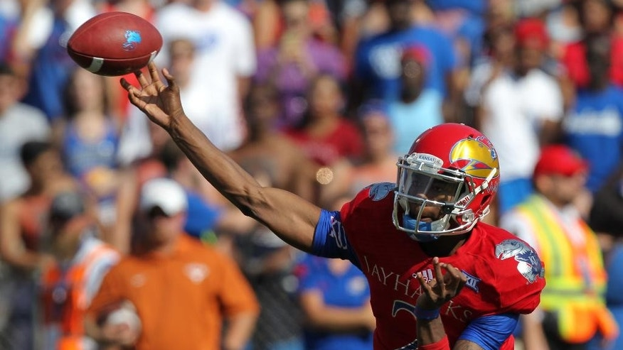 Kansas quarterback Montell Cozart throws a  pass against Texas in the first quarter of an NCAA football game against Texas, Saturday, Sept. 27, 2014, in Lawrence, Kan. (AP Photo/Ed Zurga)