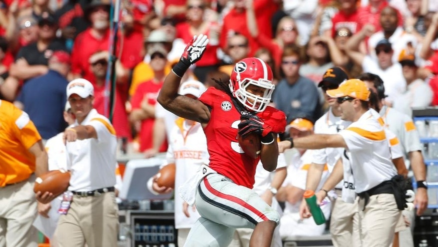 Georgia running back Todd Gurley (3) tries to stay in bounds as he runs for a first down in the first half of an NCAA college football game   against Tennessee,Saturday, Sept. 27, 2014, in Athens, Ga. (AP Photo/John Bazemore)