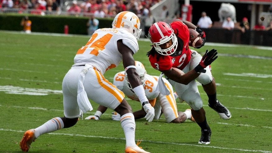 Georgia running back Todd Gurley (3) tries to get past Tennessee defensive back Michael Williams (24) during the first half of an NCAA college football game, Saturday, Sept. 27, 2014, in Athens, Ga. (AP Photo/John Bazemore)
