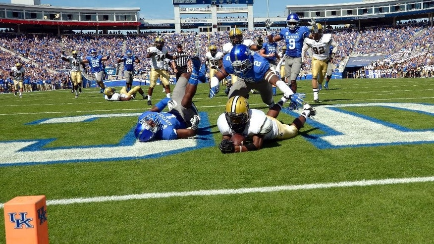 Vanderbilt's Paris Head after University of Wildcat Ryan Timmons had scored a touchdown, Saturday Sept. 27, 2014 at Commonwealth Stadium in Lexington, Ky. A review showed Timmons had held on to the ball long enough to have possession. (AP Photo/John Flavell)