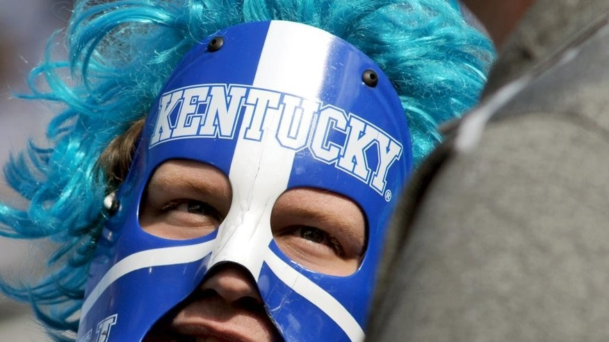 University of Kentucky student fan David Green, dressed as The UK Warrior, talks to friends Saturday, Sept. 27, 2014 before the University of Kentucky plays Vanderbilt in an NCAA college football game at Commonwealth Stadium in Lexington, Ky. (AP Photo/John Flavell)