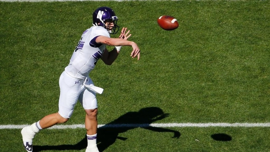 Northwestern quarterback Trevor Siemian (13) throws a pass during the first quarter of an NCAA college football game against Penn State in State College, Pa., Saturday, Sept. 27, 2014. (AP Photo/Gene J. Puskar)