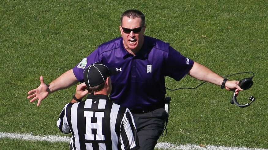 Northwestern coach Pat Fitzgerald questions a call during the first quarter of an NCAA college football game against Penn State in State College, Pa., Saturday, Sept. 27, 2014. (AP Photo/Gene J. Puskar)