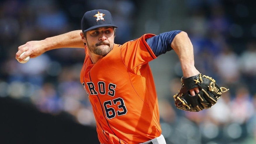 Houston Astros pitcher Nick Tropeano (63) delivers a pitch against the New York Mets during the first inning of an inter-league baseball game Sunday, Sept. 28, 2014 at Citi Field in New York. (AP Photo/Rich Schultz)