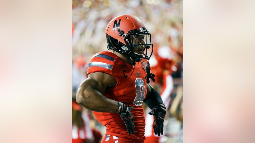 Nebraska running back Ameer Abdullah celebrates after a touchdown in the first half of an NCAA college football game against Illinois in Lincoln, Neb., Saturday, Sept. 27, 2014. (AP Photo/Nati Harnik)