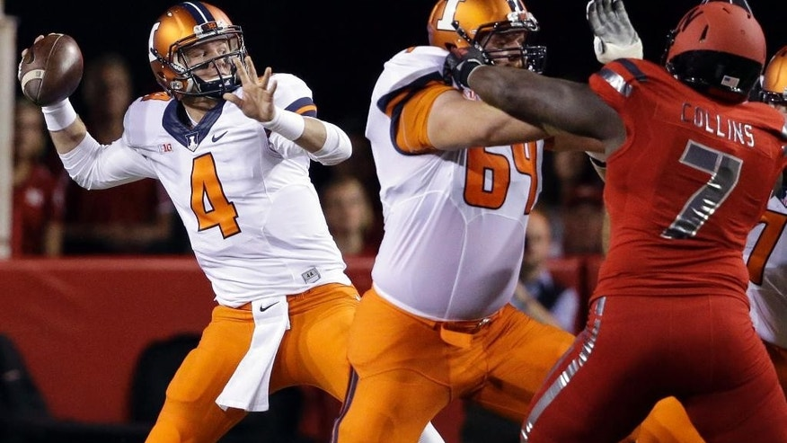 Illinois quarterback Reilly O'Toole (4) throws as Illinois offensive lineman Ted Karras (69) blocks Nebraska defensive tackle Maliek Collins (7) in the first half of an NCAA college football game in Lincoln, Neb., Saturday, Sept. 27, 2014. (AP Photo/Nati Harnik)