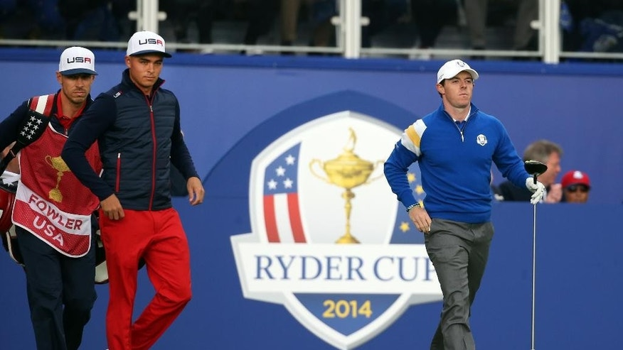 Europe's Rory McIlroy, right, and Rickie Fowler of the US prepare to play off the fire tee during the singles match on the final day of the Ryder Cup golf tournament at Gleneagles, Scotland, Sunday, Sept. 28, 2014. (AP Photo/Scott Heppell)