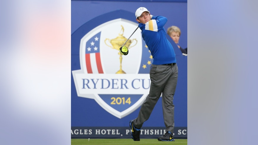 Europe's Rory McIlroy plays a shot off the 1st tee during the singles match on the final day of Ryder Cup golf tournament at Gleneagles, Scotland, Sunday, Sept. 28, 2014. (AP Photo/Scott Heppell)