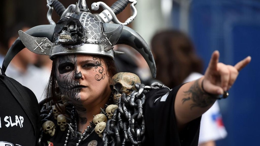 A Raiders fan poses for a picture during NFL on Regent Street, a fan rally event on Regent Street, London, England, Saturday, Sept. 27, 2014.  The Oakland Raiders will play the Miami Dolphins in an NFL football game at London's Wembley Stadium on Sunday Sept. 28. (AP Photo/Tim Ireland)