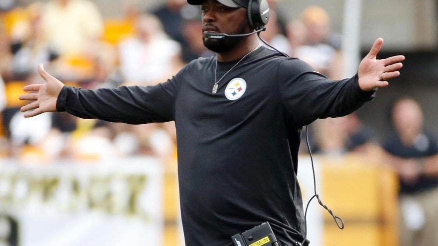 Pittsburgh Steelers head coach Mike Tomlin looks for a call in the third quarter of an NFL football game against the Tampa Bay Buccaneers, Sunday, Sept. 28, 2014, in Pittsburgh. (AP Photo/Gene J. Puskar)