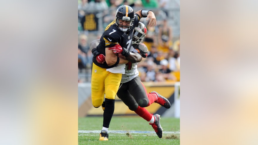 Pittsburgh Steelers quarterback Ben Roethlisberger (7) is tackled as he scrambles away from Tampa Bay Buccaneers outside linebacker Lavonte David in the third quarter of an NFL football game against on Sunday, Sept. 28, 2014, in Pittsburgh. (AP Photo/Don Wright)