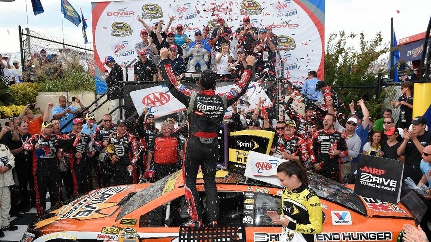 Jeff Gordon celebrates in Victory Lane after he won the NASCAR Sprint Cup series auto race, Sunday, Sept. 28, 2014, at Dover International Speedway in Dover, Del. (AP Photo/Nick Wass)