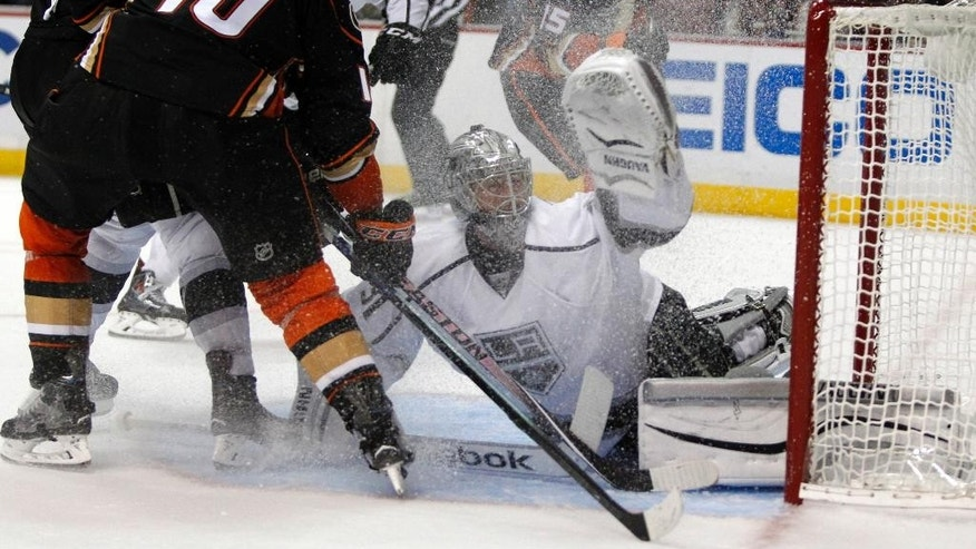 Anaheim Ducks right wing Corey Perry (10) shot hops over the net with Los Angeles Kings goalie Martin Jones, center, defending during the second period of a preseason NHL hockey game, Sunday, Sept. 28, 2014, in Anaheim, Calif. (AP Photo/Alex Gallardo)