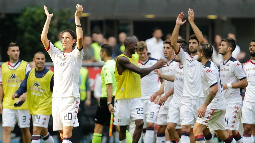Cagliari's Albin Ekdal, left, celebrates with his teammates their side's 4-1 win over Inter Milan, at the end of their Serie A soccer match at the San Siro stadium in Milan, Italy, Sunday, Sept. 28, 2014. (AP Photo/Antonio Calanni)