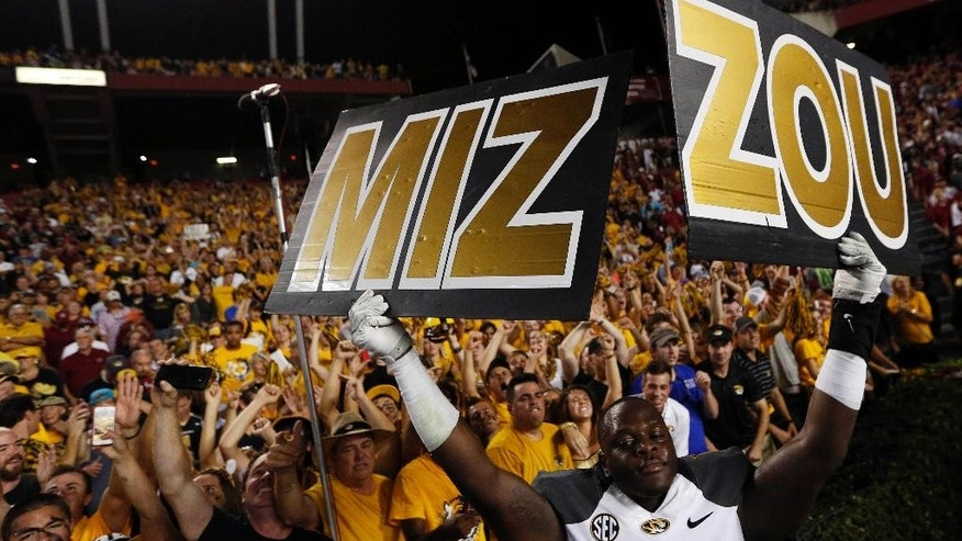 Missouri linebacker Darvin Ruise (12) holds a sign in celebration following an NCAA college football game against South Carolina on Saturday, Sept. 27, 2014, in Columbia, S.C. Missouri won 21-20.  (AP Photo/Stephen B. Morton)