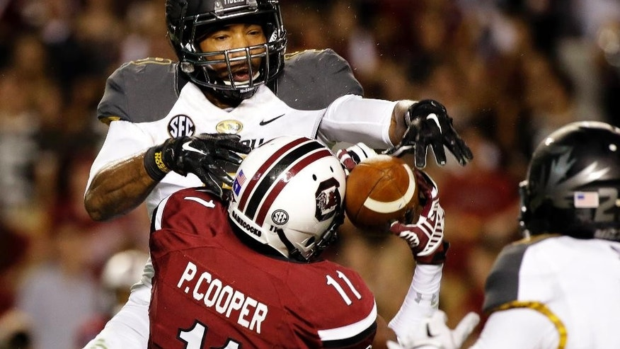 South Carolina wide receiver Pharoh Cooper (11) hauls in a touchdown while being defended by Missouri safety Braylon Webb during the second half of an NCAA college football game on, Saturday, Sept. 27, 2014, in Columbia, S.C. Missouri won 21-20.  (AP Photo/Stephen B. Morton)