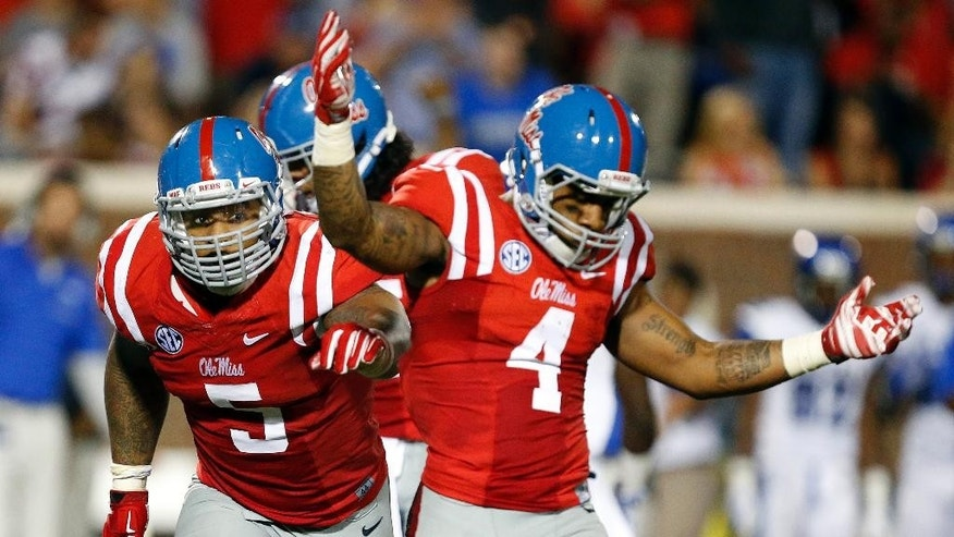 Mississippi defensive tackle Robert Nkemdiche (5) and linebacker Denzel Nkemdiche (4), his brother, celebrate Memphis quarterback Paxton Lynch fumbled during the second half of an NCAA college football game in Oxford, Miss., Saturday, Sept. 27, 2014. No. 10 Mississippi won 24-3. (AP Photo/Rogelio V. Solis)