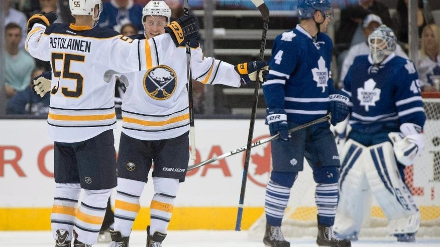 Buffalo Sabres Nicolas Deslauriers (44) congratulates teammate Rasmus Ristolainen (55) on his goal as Toronto Maple Leafs goaltender Jonathan Bernier, right, and Cody Franson react during second period pre-season NHL action in Toronto on Sunday Sept. 28, 2014. (AP Photo/The Canadian Press, Frank Gunn)