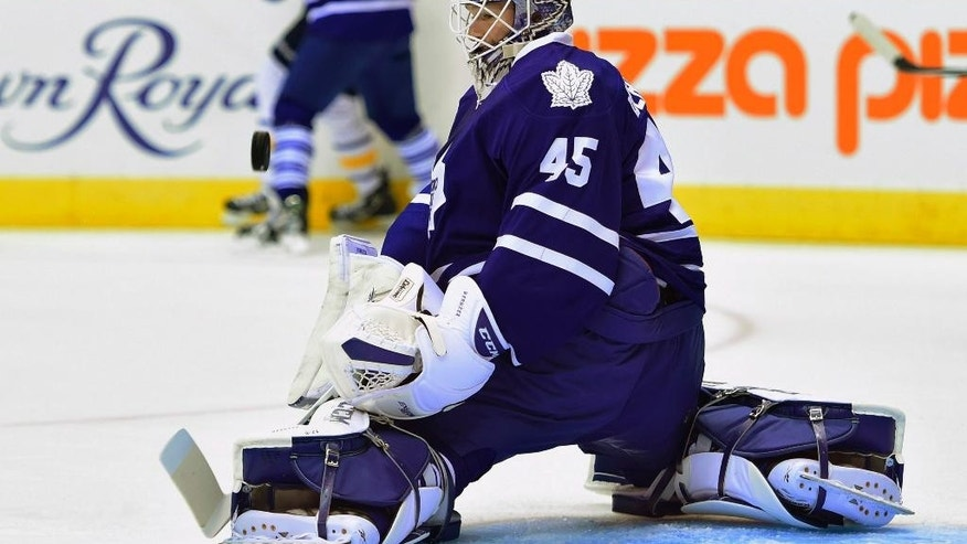 Toronto Maple Leafs Jonathan Bernier makes a save against the Buffalo Sabres during first period NHL pre-season action in Toronto, Sunday Sept. 28, 2014. (AP Photo/The Canadian Press, Frank Gunn)