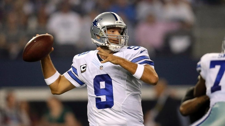 Dallas Cowboys quarterback Tony Romo looks to pass against the New Orleans Saints during the first half of an NFL football game, Sunday, Sept. 28, 2014, in Arlington, Texas.  (AP Photo/Tim Sharp)