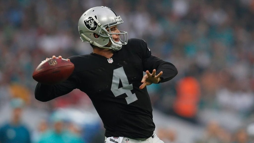 Oakland Raiders' Derek Carr passes during the first half of an NFL football game against the Miami Dolphins, Sunday, Sept. 28, 2014, at Wembley Stadium in London. (AP Photo/Lefteris Pitarakis)