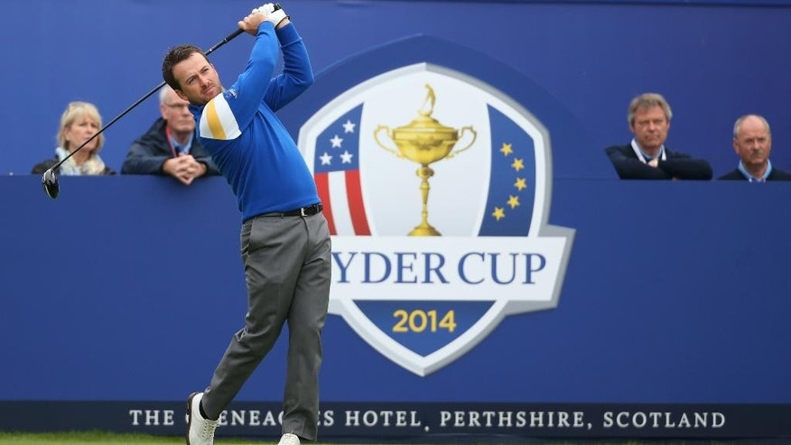 Europe's Graeme McDowell plays a shot off the 1st tee during his singles match against Jordan Spieth of the US on the final day of Ryder Cup golf tournament at Gleneagles, Scotland, Sunday, Sept. 28, 2014. (AP Photo/Scott Heppell)