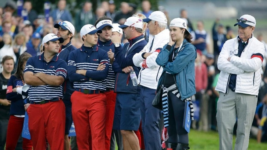 US team captain Tom Watson, right, and team members watch the singles match between Europe's Jamie Donaldson and Keegan Bradley of the US on the final day of the Ryder Cup golf tournament at Gleneagles, Scotland, Sunday, Sept. 28, 2014. (AP Photo/Matt Dunham)