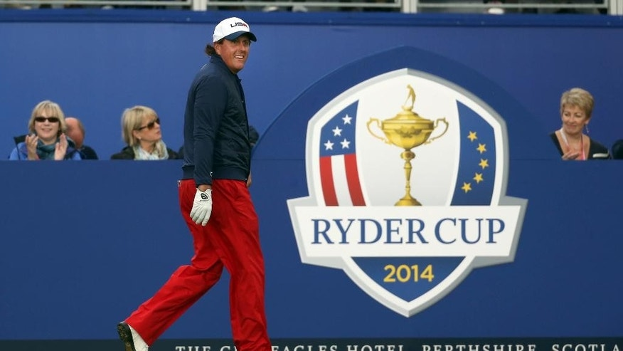 Phil Mickelson of the US walks up to the 1st tee box during the singles match on the final day of the Ryder Cup golf tournament at Gleneagles, Scotland, Sunday, Sept. 28, 2014. (AP Photo/Scott Heppell)