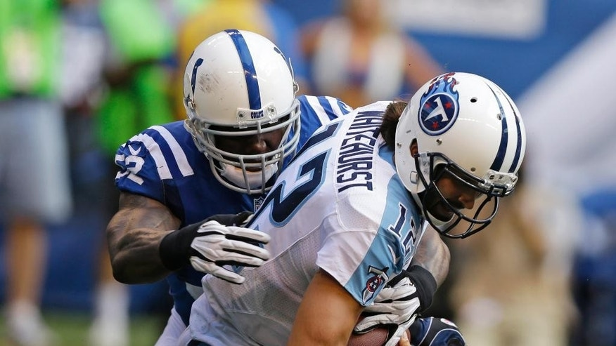 Tennessee Titans quarterback Charlie Whitehurst is sacked by Indianapolis Colts inside linebacker D'Qwell Jackson during the second half of an NFL football game in Indianapolis, Sunday, Sept. 28, 2014. (AP Photo/Darron Cummings)