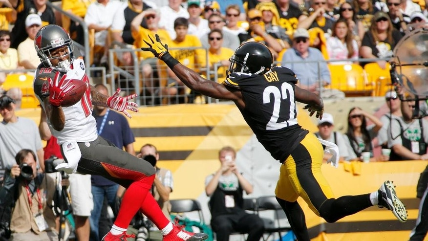 Tampa Bay Buccaneers wide receiver Louis Murphy (18) can't come up with a catch in the end zone next to Pittsburgh Steelers cornerback William Gay (22) in the fourth quarter of an NFL football game on Sunday, Sept. 28, 2014, in Pittsburgh. (AP Photo/Gene Puskar)