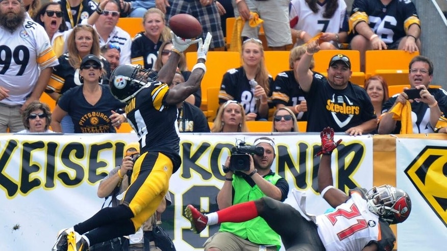 Pittsburgh Steelers wide receiver Antonio Brown (84) makes a touchdown catch over Tampa Bay Buccaneers cornerback Alterraun Verner (21) in the second quarter of an NFL football game Sunday, Sept. 28, 2014, in Pittsburgh. (AP Photo/Don Wright)