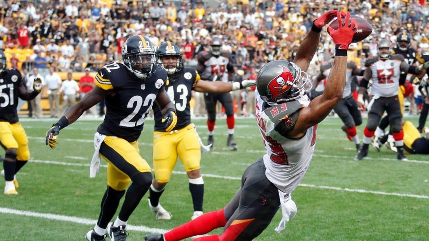 Tampa Bay Buccaneers wide receiver Vincent Jackson (83) makes a catch in front of Pittsburgh Steelers cornerback William Gay (22) for a touchdown with seven seconds left in the fourth quarter of an NFL football game on Sunday, Sept. 28, 2014 in Pittsburgh. The score lifted the Buccaneers to a 27-24 win. (AP Photo/Gene Puskar)