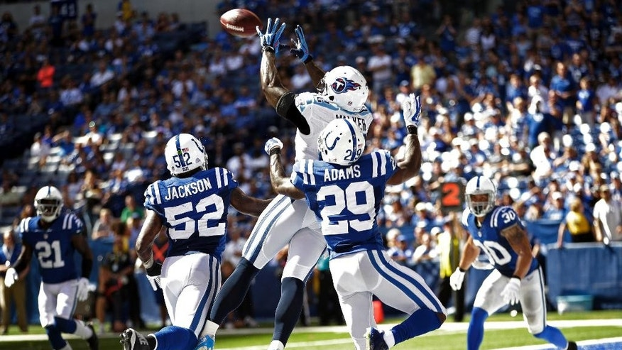 Tennessee Titans tight end Delanie Walker (82) makes a catch for touchdown in front of Indianapolis Colts strong safety Mike Adams (29) and linebacker Cam Johnson during the first half of an NFL football game in Indianapolis, Sunday, Sept. 28, 2014. (AP Photo/AJ Mast)
