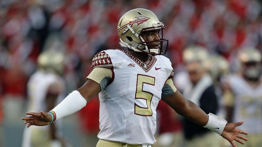 Florida State quarterback Jameis Winston (5) reacts following a touchdown against North Carolina State during the second half of an NCAA college football game in Raleigh, N.C., Saturday, Sept. 27, 2014. Florida State won 56-41.(AP Photo/Gerry Broome)